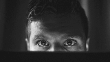 Man and computer screen